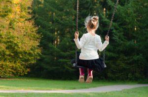 Young girl on swingset