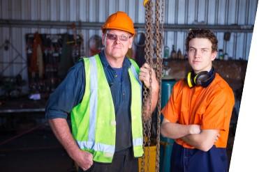 two tradesmen looking at camera