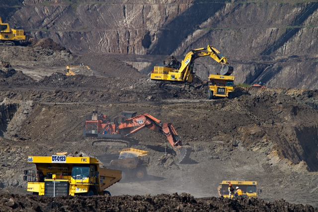mining trucks excavating
